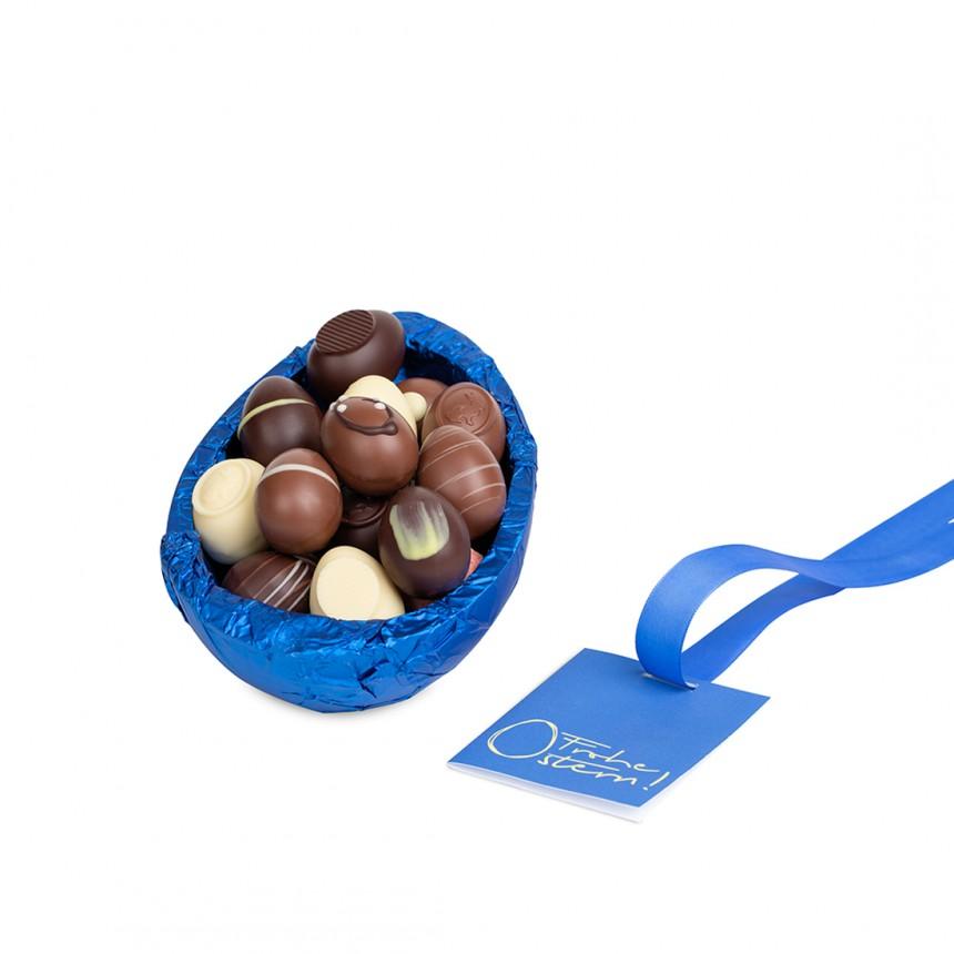Präsent-Ei Schokolade, gefüllt mit Pralinen-Eiern, 300 g